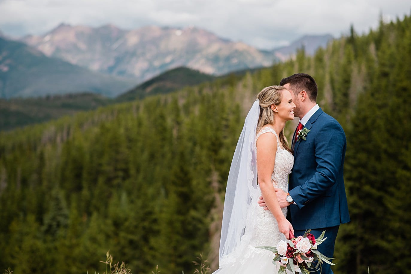 bride and groom intimate portrait at top of Vail mountain at Vail Manor Lodge wedding by Breckenridge wedding photographer Jennie Crate