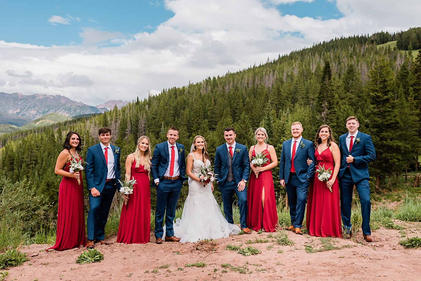 bridal party in burgundy and navy at top of vail mountain at Vail Manor Lodge wedding by Breckenridge wedding photographer Jennie Crate
