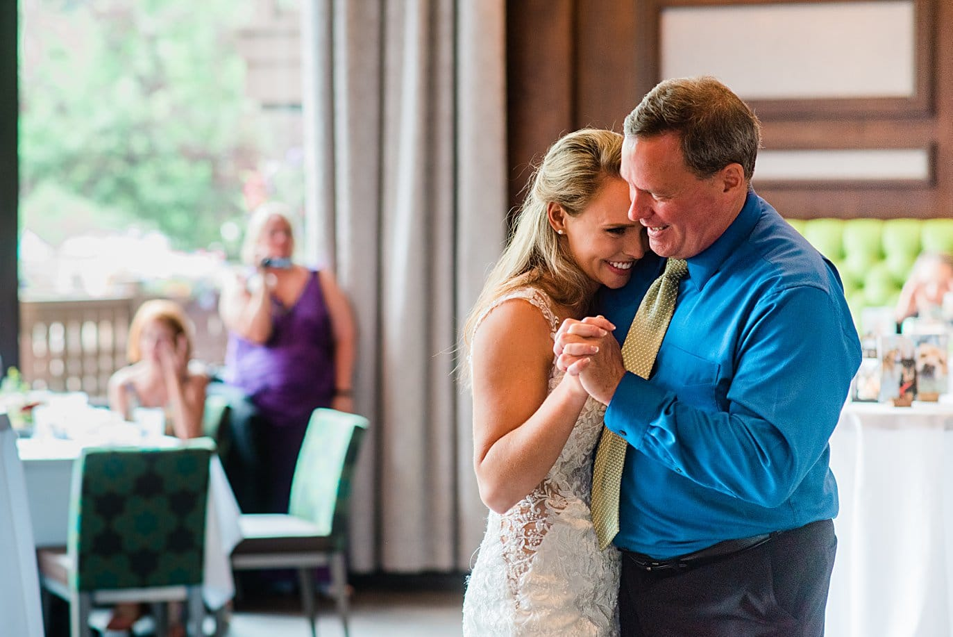 father daughter dance at summer wedding reception at Vail Manor Lodge wedding by Aspen wedding photographer Jennie Crate