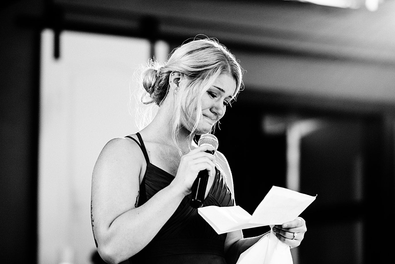 maid of honor cries during toasts at Vail Manor Lodge wedding by Aspen wedding photographer Jennie Crate
