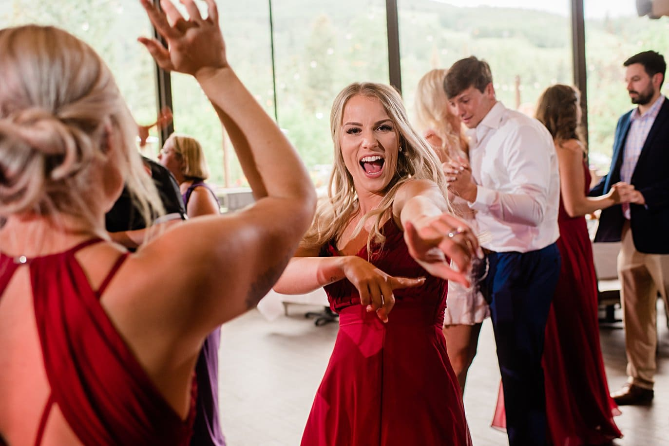 Colorado mountain wedding dance party at Vail Manor Lodge wedding by Aspen wedding photographer Jennie Crate