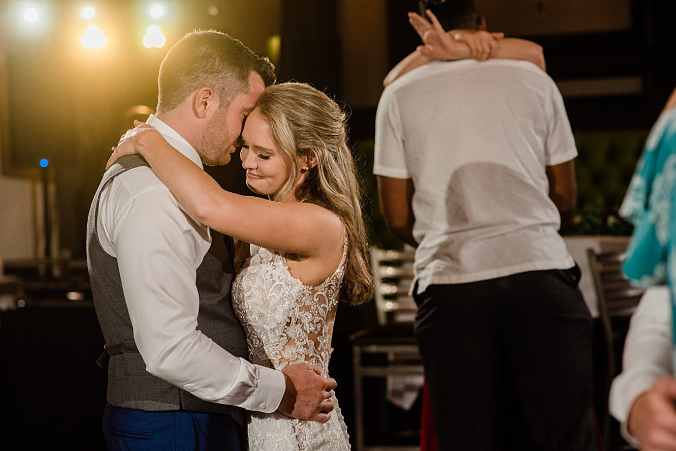 last dance between bride and groom at Vail Manor Lodge wedding by Aspen wedding photographer Jennie Crate