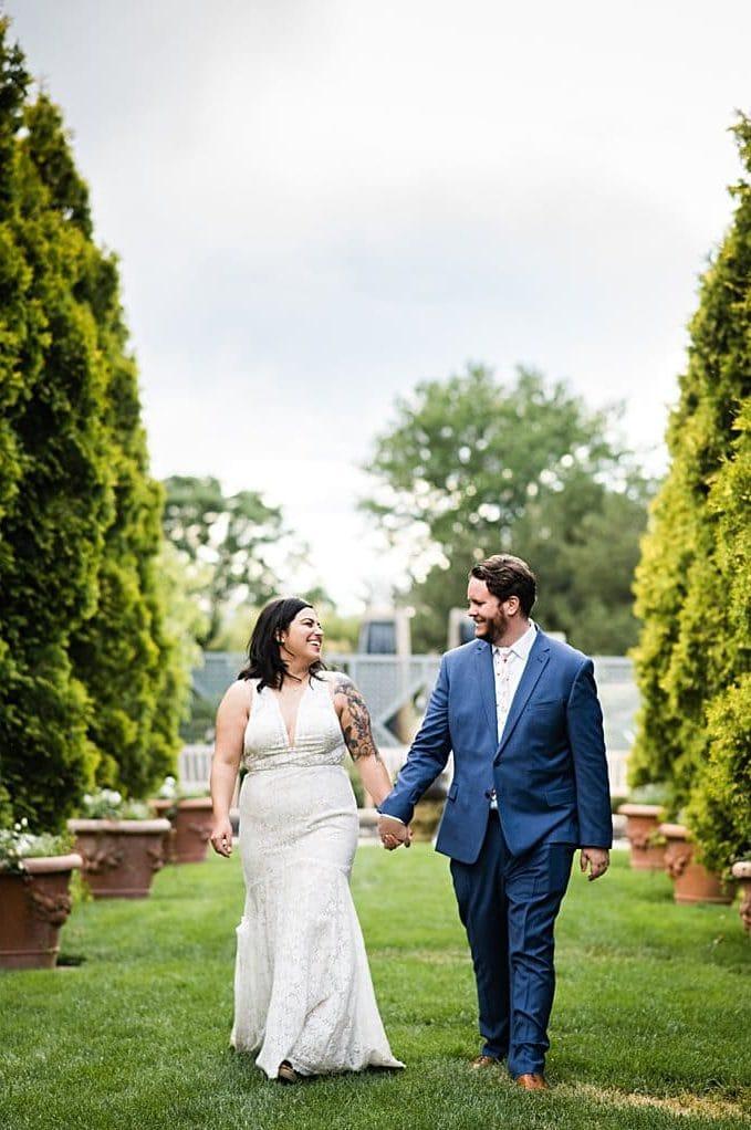 bride and groom walk in Romantic Gardens at Denver Botanic Gardens wedding by Boulder Wedding Photographer Jennie Crate